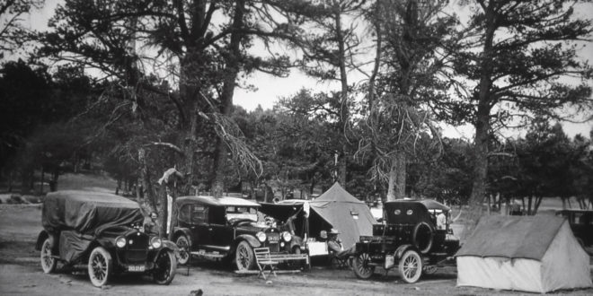 Visitors beside tents & model A's;Photographer unknown;No date